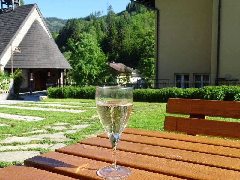 Enjoy a drink on the terrace at Haus Schneeberg